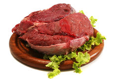 Beef meat and salad over white on plate Royalty Free Stock Photos