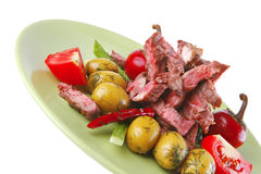 Beef meat served on green Royalty Free Stock Images