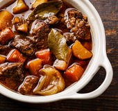 Beef meat stewed with potatoes, carrots and spices Stock Image