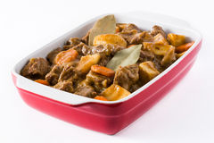 Beef meat stewed with potatoes, carrots and spices in ceramic pot isolated Stock Images
