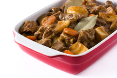 Beef meat stewed with potatoes, carrots and spices in ceramic pot isolated Stock Photos