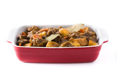 Beef meat stewed with potatoes, carrots and spices in ceramic pot isolated Royalty Free Stock Photos