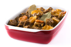 Beef meat stewed with potatoes, carrots and spices in ceramic pot isolated Royalty Free Stock Images