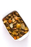 Beef meat stewed with potatoes, carrots and spices in ceramic pot isolated Royalty Free Stock Photography