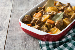 Beef meat stewed with potatoes, carrots and spices in ceramic pot Stock Photography