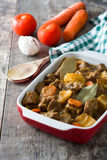 Beef meat stewed with potatoes, carrots and spices in ceramic pot Stock Image