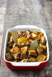 Beef meat stewed with potatoes, carrots and spices in ceramic pot Stock Images