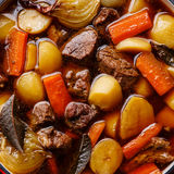 Beef meat stewed with potatoes close up Stock Photos