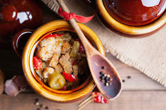 Beef meat stewed with vegetables in ceramic pot. Photography of a beef meat stewed with vegetables in ceramic pot Royalty Free Stock Image