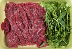 Beef meat. With vegetables in container Stock Image