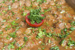 Beef meatballs in tomato sauce at an oriental buffet Stock Photography