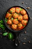 Beef meatballs in tomato sauce. And parsley stock photography