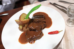 Beef medallions. The beef medallions on a white plate with cayenne Stock Photography