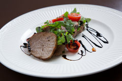 Beef medallions served with balsamic sauce Stock Images