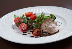 Beef medallions served with balsamic sauce Royalty Free Stock Photography
