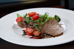 Beef medallions served with balsamic sauce Royalty Free Stock Photo