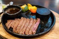 Beef medium rare steak sliced on hot stone pan. In japanese restaurant stock photo