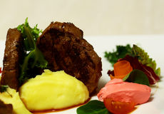 Beef mignon with mashed potato. Grilled beef filet mignon steak with mashed potato, vegetables and salad on plate on blurred white background. Modern molecular stock photos