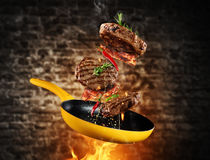 Beef milled meat flying from a pan Royalty Free Stock Photography