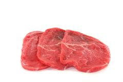 Beef minute steaks. Three raw beef minute steaks on a white background royalty free stock image
