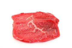 Beef minute steaks. Three raw beef minute steaks on a white background royalty free stock photos