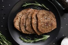 Beef minute steaks with rosemary. Picture of beef minute steaks with rosemary Royalty Free Stock Images