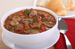 Beef and Mushroom Soup. Bowl of beef and mushroom soup with red pepper and parsley Stock Images