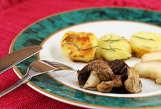 Beef with mushrooms. On elegant plate Stock Photos