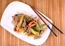 Beef with mushrooms, baby corn, carrots in peanut sauce Stock Images