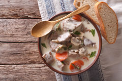 Beef with mushrooms in cream sauce in a bowl. horizontal top vie Royalty Free Stock Images