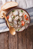 Beef with mushrooms in cream sauce in a bowl. Vertical top view Royalty Free Stock Image