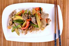 Beef with mushrooms, peppers, baby corn in peanut sauce Stock Photography