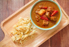 Beef mussaman curry eat with roti on wood Stock Photos