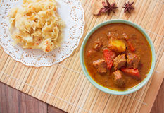 Beef mussaman curry eat with roti on wood Royalty Free Stock Photos