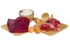 Beef, mutton, flour, onions Stock Photography