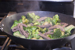 Beef n broccoli. Beef and broccoli in a wok. hot and fresh with steam rising Stock Photos