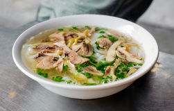 Beef noodle with hot soup in a white bowl Stock Photography