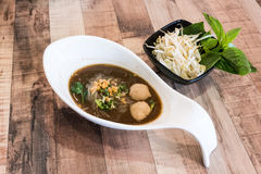Beef noodle soup with meat ball served with bean sprout and holy Stock Photography