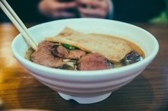 Beef noodles, Chinese noodles, soup. Beef noodles with green scallions,in a bowl stock image