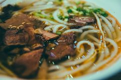 Beef noodles, Chinese noodles, soup. Beef noodles with green scallions,in a bowl stock photography