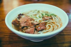 Beef noodles, Chinese noodles, soup. Beef noodles with green scallions,in a bowl stock photo