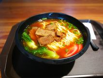Beef noodles. With tomato and Green vegetables royalty free stock photos