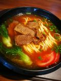 Beef noodles. With tomato and Green vegetables stock photography