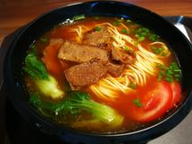 Beef noodles. With tomato and Green vegetables royalty free stock image