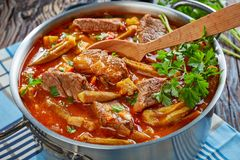 Beef and Okra Stew in a metal pot stock photos