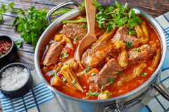 Beef and Okra Stew in a metal pot royalty free stock image