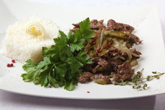 Beef with onions and rice side dish Stock Images