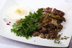 Beef with onions and rice side dish Stock Photos