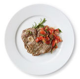 Beef osobuko (osso bucco). On a white plate, top view Royalty Free Stock Photo