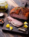 Beef pastrami sliced, roasted beef, slow cooking, marinated in olive oils eggplants on wooden board. Royalty Free Stock Image